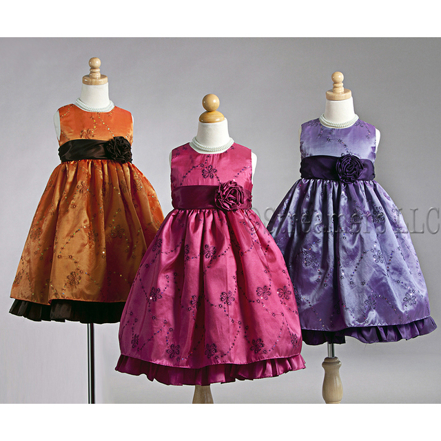 Beautiful Flower Girl Dresses in Striking Colors of Fuchsia and Purple with Metallic Threading and Sequins that Transform into Flowers and Vines with Bold Flower and Sash that Ties at Back.  Beautiful! Available in Sizes 5/6, (Also available in Toddler Girl, Orange available in 7/8, 9/10) by Crayon Kids