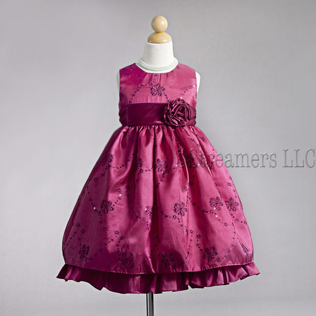 Flower Girl Dresses in Striking Colors of Fuchsia or Purple with Metallic Threading and Sequins that Transform into Flowers and Vines with Bold Flower and Sash that Ties at Back.  Beautiful! Available in Sizes 2T, 3T and 4T (Also available in size 5/6) by Crayon Kids