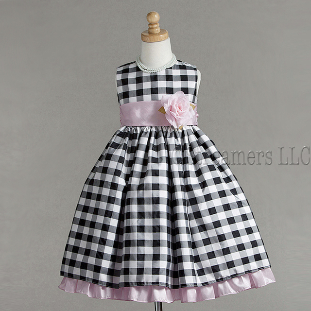 Special Occasion Dress by Crayon Kids, Pretty Dress in Black and Silver Plaid with Pink Sash with Flower that Ties in Back. Pink Ruffled Skirt Underneath. So Cute! Available in Sizes 5/6, Tween Girl 7/8 and 9/10 (Dress is Quite Long)