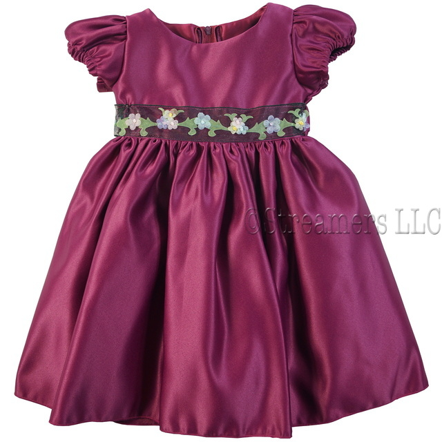 This cute holiday dress has a flattering sheen to it with a ribbon waistband with flowers and leaves, zips and ties at back. Has a crinoline skirt to give it just the right amount of puffiness! Available in Green and Beet Red in sizes 12, 18 and 24 months. Made in the USA