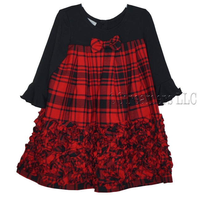 This is a cute red plaid dress with black top and sleeves and plaid bodice that leads to a cascade of bonaz trim.  Two buttons at back.  Available in sizes 2T, 3T and 4T (See also in 4-6X) by Bonnie Jean