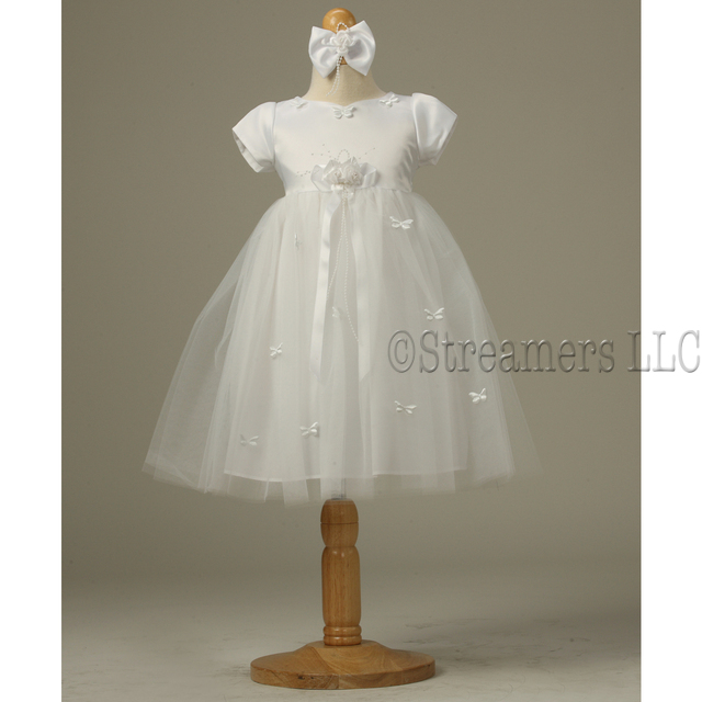 Sweet baby girl white tutu dress with satin bodice with puffy butterfly appliques. Flower and bow accent at waist. Buttons and ties at back.  Matching headband with satin bow and flower.  Available in sizes 6/9, 12, 18 and 24 months. Made in the USA by Kid Collection
