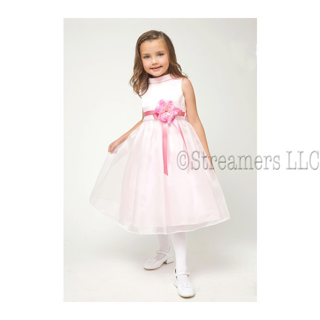 Darling First Communion dress/Flower Girl Dress with a rolled collar, flower (removable) and ribbon sash with zip and ties at back.  Below the knee length.  Very Sweet!  Available in White and Pink in sizes 6, 8, and 10