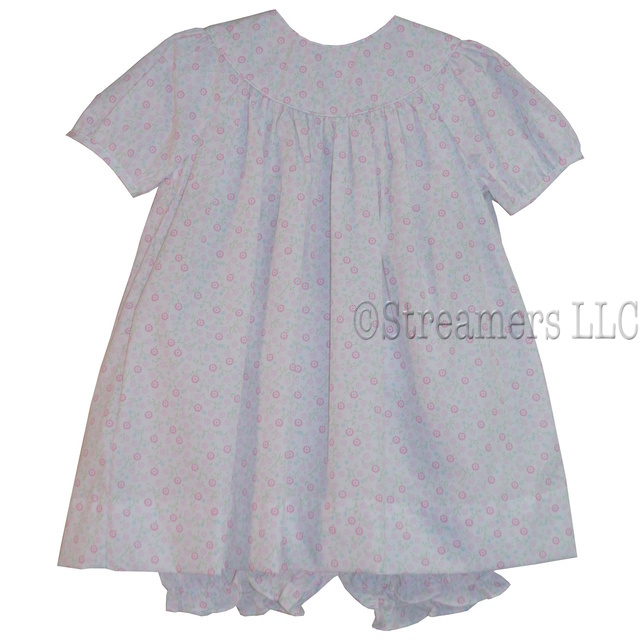Adorable floral dress set with light pink and hot pink flowers, bishop style neckline that could be monogrammed, short sleeves and matching panty.  Available in Sizes 12, 18, 24 mos.  See matching dress in Baby Girl.  by Petit Ami