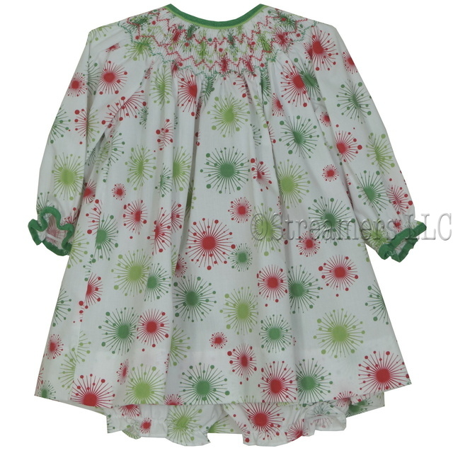 Colorful baby girl dress in red and green starburst print, smocked bishop neckline, and coordinating corduroy trim.  Comes with matching panty. Great for the holidays!  Available in sizes 3, 6, and 9 months.  See also Infant and Toddler Girl sizes.  by Petit Ami
