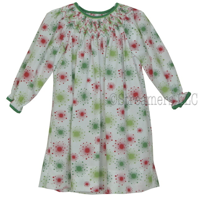 Colorful toddler girl dress in red and green starburst print, smocked bishop neckline, and coordinating corduroy trim. Great for the holidays!  Available in sizes 2T, 3T, and 4T.  See also Infant and Baby Girl sizes.  by Petit Ami