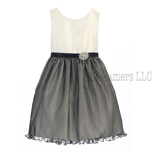 This cute ivory and black fancyy dress has a pleated black skirt over the ivory organza dress, removable sparkly pin, belt loops with black ribbon belt that ties in back.  Classic Style! Available in sizes 5 and 6 (see also in 7 and 8) by Sweet Kids