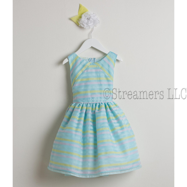 Sweet toddler girl dress in directional stripe organza in pastel colors of blue, pink and yellow. Crinoline skirt gives a bit of puff. Zips and ties at back.  Great for Birthdays, Weddings or any Special Occasion! Available in sizes  2, 3 and 4 (see also Infant sizes 6/9, 12, 18 and 24 months and girls 6-8) by Sweet Kids