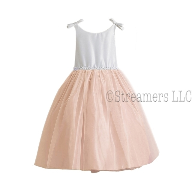 This adorable flower girl dress is in two tones, bodice is off-white and skirt is in an antique pink with a tulle overlay that is trimmed in ribbon and faux pearls.  There are bows at the shoulders. Zips and ties in back. Sweet!  Available in sizes 8, 10.  (see also sizes 2,4 in Toddler and 6) Made in the USA by Sweet Kids
