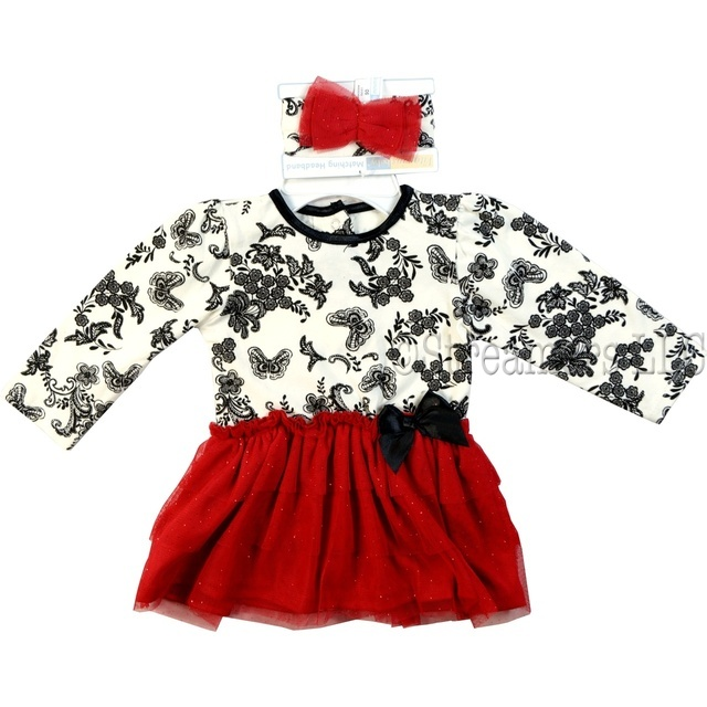 This adorable tutu onesie is in an ivory and black damask print with an attached red glitter tiered tutu over polyester skirt topped with a black bow.  Includes matching headband.  So sweet!  Available in Sizes 12, 18, and 24 months (Also available in 3, 6 and 9 months) by Vitamins