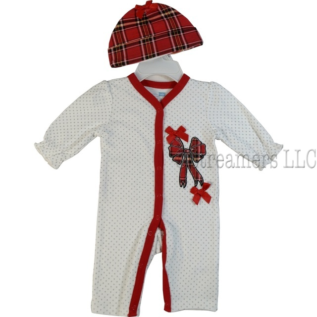 This adorable white layette is embossed with silver polka dots, a red tartan bow applique, satin bows, red trim and a tartan ruffled bum.  Comes with a red tartan hat and Mary Jane socks with bows.  So cute!  Available in sizes Newborn, 3, 6 and 9 months by Vitamins