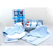 Baby Boy Gift Sets, Six piece set of clothing cupcakes from BabyBlooms are actually cleverly disguised play sets and bibs for boys.  The ribbon-tied bakery box contains two pairs of blue and white candy striped trousers (pull-on) and co-ordinating long-sleeved blue tee and white tee and one each: blue bib, white bib.  So Cute!  Available in Sizes 0-6 and 6-12 months. NOTE: 100% cotton, not flame-resistant. Not intended as sleepwear.