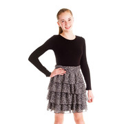 This cute tween dress looks like it is two pieces but is actually one!  It has a long black cotton dress with a skirt overlay of chiffon floral tiers. Slips on over the head.  Darling!  Available in sizes 7, 8, 10, 12 and 14