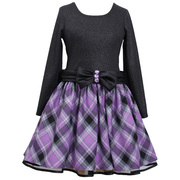 This is a cute holiday dress in a long sleeved foil knit bodice with a purple plaid skirt and a peek-a-boo crinoline layer for fullness, pleated waistband with purple rhinestone buttons. Zips and ties at back.  Available in sizes 2T, 3T and 4T by Bonnie Jean