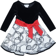 Cute dress with a black stretch velvet bodice to a shimmering white skirt with velvet circles, silver glitter dots, a wide red bow and a lined, black velvet trimmed crinoline skirt to add a touch of fullness.  Available in sizes 2T, 3T and 4T by Bonnie Jean