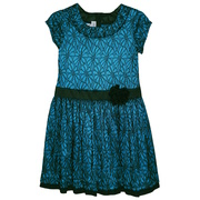 This vibrant dress has a turquoise background with a black floral lace overlay, drop waist band with a flower and a black hem.  Available in sizes 7, 8, 12, 14 and 16 by Bonnie Jean