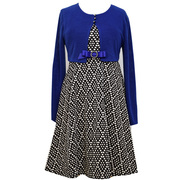 Great special occasion dress in a sleeveless polka dot/diamond knit jacquard dress that ties in back with a royal blue ribbon with rhinestone pin and long sleeve knit royal blue cardigan. Great for recitals, parties and holidays. Available in sizes 7, 8 by Bonnie Jean
