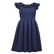 Great plus girl dress in navy knit jacquard with box pleats, bonaz floral embellishment at neckline with black buttons and beads, a small crinoline skirt and a tie and zip at the back.  Great for dressing up!  Available in sizes 14 1/2, 16 1/2, 18 1/2 and 20 1/2 (see also in 7-16)