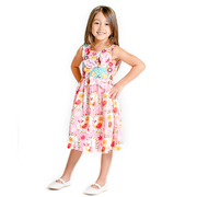 This adorable Jelly the Pug dress with a peep pattern and bright Spring colors will bring a smile to any girl