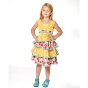 This sweet Jelly the Pug dress is in layers of bright yellow and floral prints that drop below the knee and buttons and ties in back.  Let the twirling begin!  Available in sizes 2T and 4T (see also sizes 4-6)