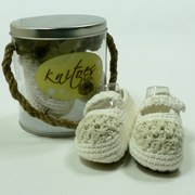 Knitted Baby Shoes by Knitoes, Adorable Knit Mary Janes in Cream and Natural with Button Strap and Suede Sole.  Comes in a Presentation Pail with Rope Handle. Too Cute!  Available in sizes Newborn and 6-12 Months (Individually boxed to protect pail)  Makes a Great Shower Gift!