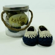 Baby Shoes by Knitoes, Beautiful Knit Baby Slippers with Navy and Natural Upper and Soft Suede Soles.  Comes in a Presentation Pail with Rope Handle. Very Sweet!  Available in sizes Newborn, 3-6 Months and 6-12 Months (Individually boxed to protect pail)  Makes a Great Shower Gift!