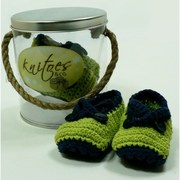 Baby Booties by Knitoes,  Colorful Knit Baby Booties  with Criss-Cross Straps that Button and Soft Suede Soles.  Comes in a Display Pail with Rope Handle. Too Cute!  Available in sizes Newborn, 3-6 Months and 6-12 Months (Individually boxed to protect pail)  Makes a Great Shower Gift!