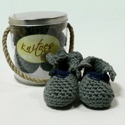 Baby Booties by Knitoes, Warm Knit Ankle Booties in Grey with Lettuce Ruffle around Ankle and Navy Trim.  Soft Suede Soles.  Comes in a Gift Pail with Rope Handle. Simply Adorable!  Available in sizes Newborn, 3-6 Months and 6-12 Months (Individually boxed to protect pail)  Makes a Great Shower Gift!