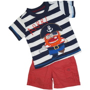 Cute Infant Boy Shorts Set with a Striped Tee with an Extensive Pirate Applique together with Red Half-Elastic Waist Shorts with Belt Loops and Pockets.  Cute!  Available in Sizes 12 and 18 months by Nannette Boyz Wear