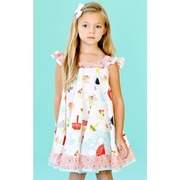 Jelly the Pug Opal Swirl Dress, Adorable Dress in Fun Pattern with Baskets and Flowers in Summer Colors.  Trimmed in Orange Stylized Spirals. Elasticized Flutter Sleeves and Keyhole Tie at Back.  So Cute!  Available in Sizes 7 and 8.  Style: Opal Swirl