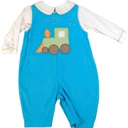 This is a cute pinwale corduroy coverall with a colorful train applique. The coverall snaps at legs and buttons at back.  Comes with a white faux shirt with Peter Pan collar trimmed in green mini-check .  Available in sizes 3, 6 and 9 months by Petit Ami