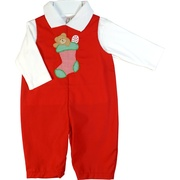 This is a cute holiday red coverall with a Christmas stocking applique that includes a teddy bear and candy cane. The coverall snaps at legs and buttons at back.  Comes with a white polo shirt.  Available in sizes 12, 18 and 24 months (see also in Baby Boy) by Petit Ami