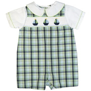 This cute outfit has extensive sailboat smocking on a green and navy blue plaid shortall with a faux white shirt with a Peter Pan collar.  The shortall is fully lined and snaps at bottom and buttons at back. Classy! Available in sizes 3, 6 and 9 months by Petit Ami