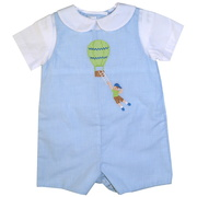 This fun Petit Ami shortall has extensive embroidery of a boy and a hot air balloon.  The shortall is in a blue mini check pattern with a white Peter Pan collar on the faux shirt.  The shortall snaps at the bottom and buttons in the back.  Too cute!  Available in sizes 3, 6 and 9 months. (see also in 12-24 months)