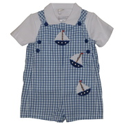 This adorable sunsuit set is in a navy windowpane plaid with sailboat appliques and has a separate white polo. Too cute!  Available in sizes 3, 6, and 9 Months (see coordinating dresses for girls) by Petit Ami