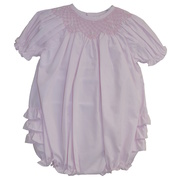 This adorable bubble has a bishop smocked neckline (lined at chest), ruffled bum and matching pink ruffled hat. Available in size Preemie (up to 7lbs)  See matching sister dress in Newborn size.