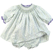 This beautiful dress set is in a dainty lilac and green floral print with intricate bishop smocking with tiny rosettes. The neckline and cuffs are trimmed in purple cord. Has a matching floral bloomer. Available in sizes 12, 18 and 24 months by Petit Ami
