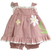 This adorable apron dress set is made of seersucker material in red with white ruffle trim, flutter cap sleeves, butterfly and flower embroidery (lined at chest for comfort), and matching red panty.  Available in sizes 12, 18 and 24 months. See also in 3, 6 and 9 months in Baby Girl.  Zu by Petit Ami