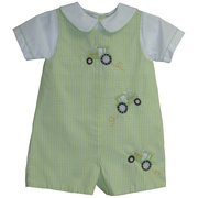 This is a cute shortall in green check with embroidered tractors on front and faux Peter Pan collared shirt.  Snaps at legs and buttons in back.  It is also fully lined.  Very cute!  Available in sizes 3, 6 and 9 months.  *See also Infant sizes 12, 18 and 24 months.
