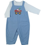 This blue check coverall has a monster truck applique with yellow flame embroidery. The coverall snaps at legs and buttons at back and has two back pockets.  Comes with a white shirt.  Available in sizes 12, 18 and 24 months by Petit Ami