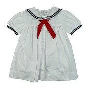 Baby Girl Sailor Dress by Petit Ami with White Collar and Sleeves Trimmed in Navy, Red Tie and Matching Panty.   Available in White and Navy in Sizes 3, 6, and 9 Months.  See Matching Outfits in Infant Girl, Newborn Boy and Infant Boy.