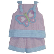 This is a cute seersucker short set with a large butterfly applique (lined at chest for comfort) on the top that buttons in back and pull-on shorts.  Available in sizes 12, 18 and 24 months.  See also in Toddler Girl sizes.  Zu by Petit Ami