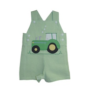 This cute green seersucker jon jon has an extensive tractor applique on the front with buttons at the sides and shoulders, two pockets on the back and snaps at the legs.  It is lined at the chest for comfort. Great for those hot Summer days!  Available in sizes 3, 6 and 9 months Zubels by Petit Ami. See also Infant Boy sizes.
