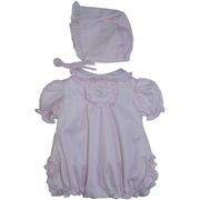 Sweet preemie girl romper in a baby pink color with embroidered floral tab, ruffled collar, hat and bum. Adorable! Size Preemie.