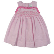 Cute Petit Ami Toddler Girl Seersucker Dress in Pink and White Stripes with Smocking on the Front with Pink Ruffle Trim. It Buttons at Back. Adorable!  Available in Sizes 2T, 3T, 4T (See Matching Sister Dress in Infant Girl Sizes)