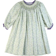 This beautiful dress is in a dainty lilac and green floral print with intricate bishop smocking with tiny rosettes. The neckline and cuffs are trimmed in purple corduroy.  Available in sizes 2T, 3T and 4T, no bloomer. (see sister dresses in Baby and Infant Girl) by Petit Ami