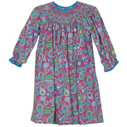 Colorful toddler girl dress in fun paisley print, smocked neckline with faux pearls and coordinating trim.  Fun!  Available in sizes 2T, 3T, and 4T.  See also Baby and Infant Girl sizes.  by Petit Ami