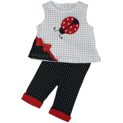 This cute black and white polka dot pant set has a Big red ladybug applique and red bow on the white/black top with inverse pants with red cuffs.  Really cute!  Available in sizes 0/3, 3/6 and 6/9 months by Rumble Tumble