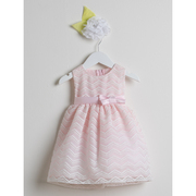 Beautiful baby girl pink chevron organza dress with sash and bow that ties in back. Crinoline skirt helps give it a touch of puffiness. Dress falls below the knee. The extensive chevron pattern is machine stitched. So cute!  Great for weddings, birthdays or any special occasion.  Available in sizes S(6/9 mos) M (12 mos) L (18 mos) XL (24 mos) See also Toddler Girl sizes Made in the USA by Sweet Kids